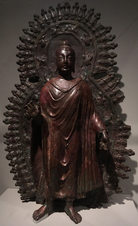 Gandharan-Style Buddha. Afghanistan; 6th-7th century. Metal alloy. About 18 inches high. Rubin Museum, NYC.