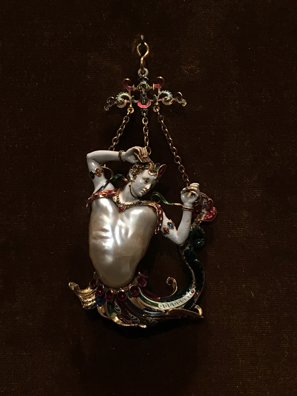 Pendant in the form of a siren. Baroque pearl with enameled gold mounts set with rubies. European, probably about 1860. Metropolitan Museum of Art.